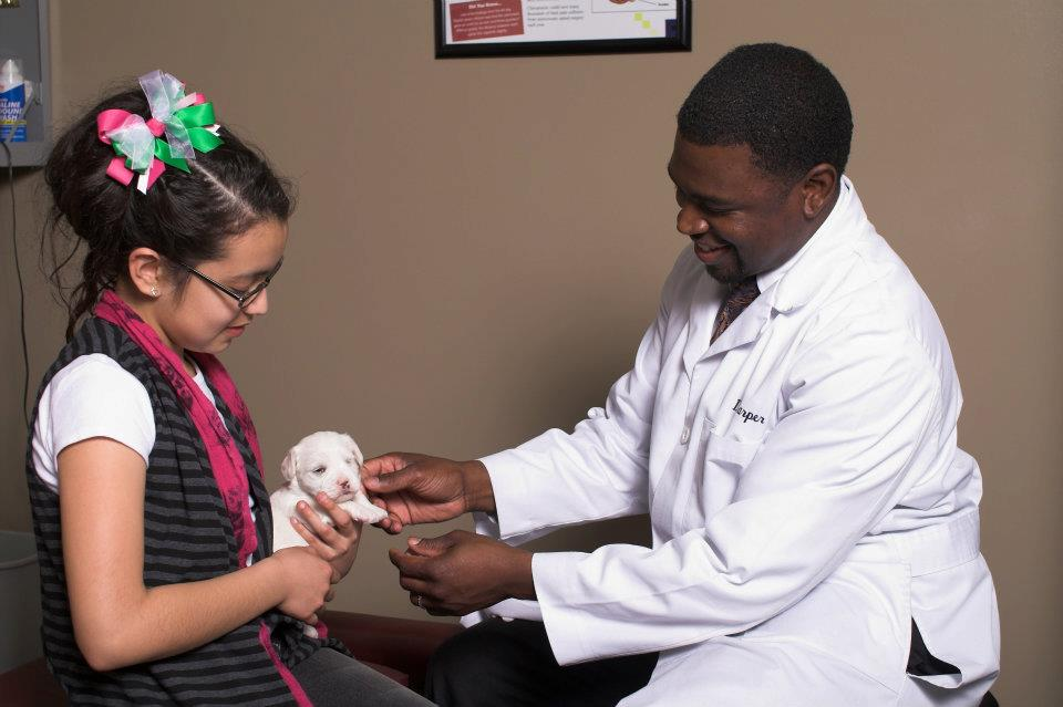 Dr  with patient and puppy